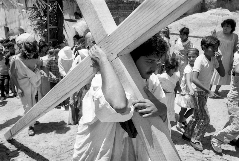 Christ carries the cross during Via Cruces