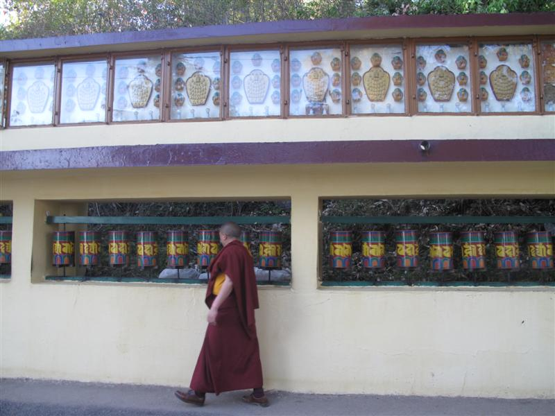 A monk does the Prayer wheels