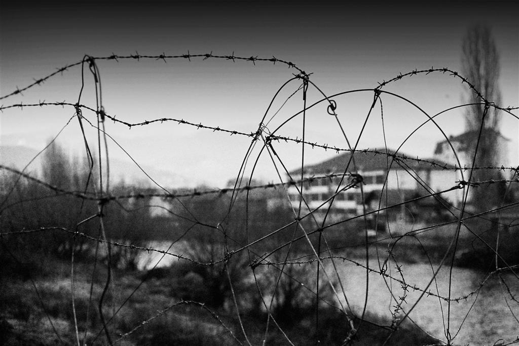 Barbed wire separates the Serbian and Albanian territory in Kosovska Mitrovica