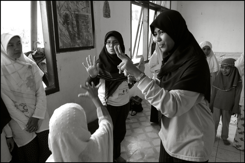 Students of the Fajar Hidayah organization play a game with girls at an orphanage in Banda Aceh Indonesia