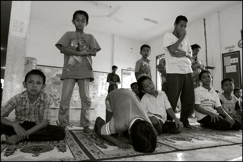 The boys during their midday prayer at an orphanage in Banda Aceh Indonesia