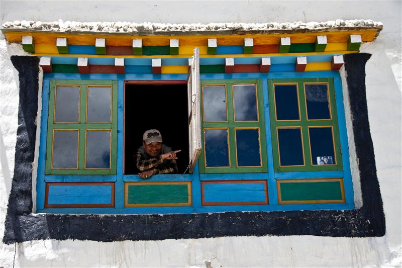 A local Loba women gives directions from my traditional styled window in Lo Manthang