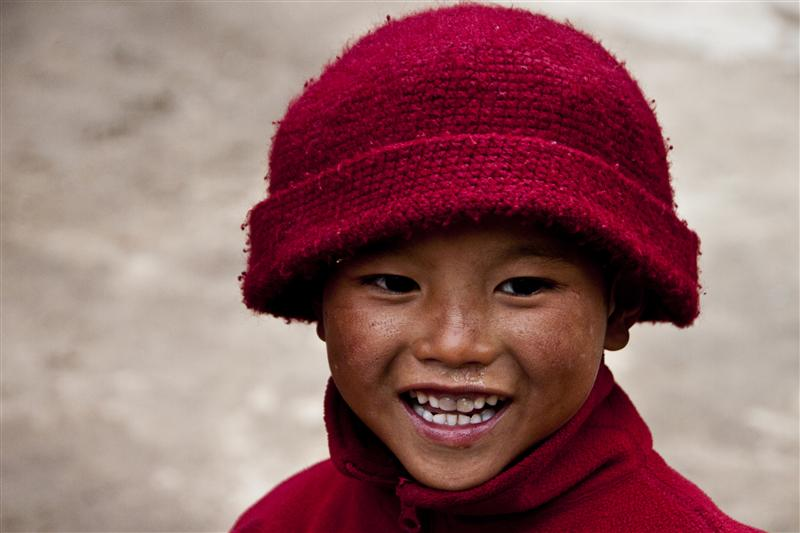 A portrait of a young monk that enjoys a moment.