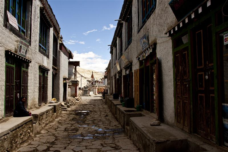 One of the main streets in the village of Lo Manthang, in a place where over 700 residents live inside and outside of the walls of Lo Manthang, Upper Mustang
