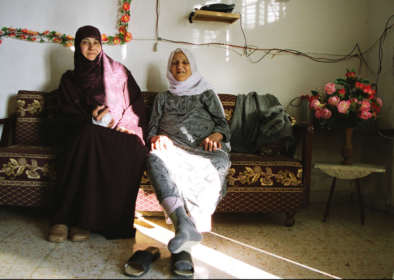 Aliya, a cluster bomb victim, with her mother, Adchit, Lebanon