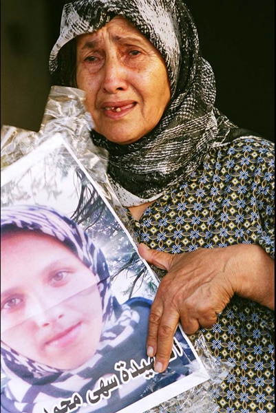 Mother holding a picture of her killed daughter, Marwaheen, Lebanon