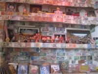 Tibetan Namgyal Cafe in Dharamsala, the exile town of Tibetans  with dcorated with paper money and coins given by tourist all over the world
