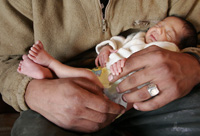 Newborn in father's hands