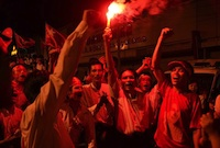 NLD supporters rally together as night falls on the polling day