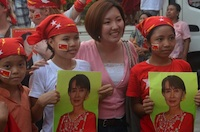 Young NLD supporters and their mother pose for a press photo on polling day in Rangoon
