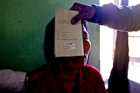 Assessing the vision of a patient following cataract surgery at Hakha Eye Centre