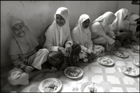 Girls having their lunch at an orphanage in Banda Aceh Indonesia