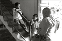 Two boys talk to a woman at an orphanage in Banda Aceh Indonesia
