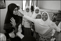 Students of the Fajar Hidayah organization play a game with the girls at an orphanage in Banda Aceh Indonesia