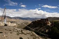 A glimpse of the Tsarang monastery surrounded by forbidding mountains.