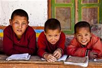 Three monks in the monastic school enjoy a moment in Upper Mustang