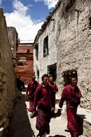 Young monks come out of the monastery for a break after prayers in Lo Mantang